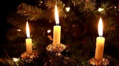 stock-footage-three-lit-candles-on-a-christmas-tree-and-at-the-end-being-blown-out-closeup-hd
