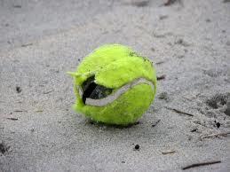 broken tennis ball